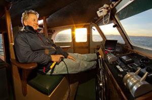 at the wheel,